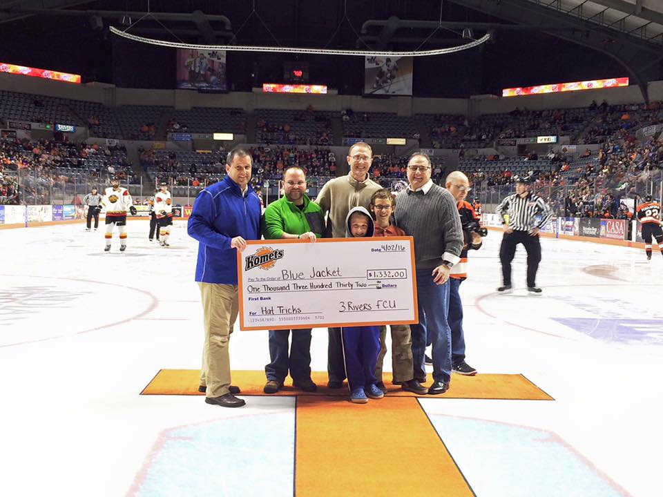3Rivers CEO, Don Cates, presents Blue Jacket, Inc. with a check during a Komets game, April 2016.
